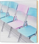 One Pink Chair In A Row Of Blue Chairs Wood Print