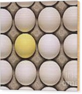 One Yellow Egg With White Eggs Wood Print