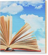 Open Book Against A Blue Sky Wood Print