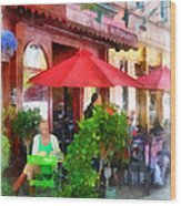 Outdoor Cafe With Red Umbrellas Wood Print