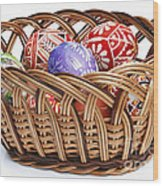 painted Easter Eggs in wicker basket Wood Print