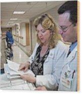 Palliative Nurse And Doctor Wood Print