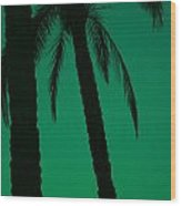 Palm Trees And Emerald Sky. Wood Print