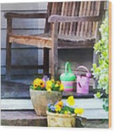 Pansies And Watering Cans On Steps Wood Print