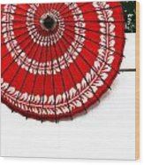 Paper Umbrella With Swirl Pattern On Fence Wood Print