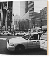 Passenger Gets Out Of Rear Door Of Yellow Taxi Cab On 7th Avenue New York City Usa Wood Print