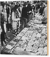 people buying chocolates on display inside the la boqueria market in Barcelona Catalonia Spain Wood Print