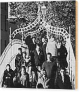 People Crossing The Hapenny Ha Penny Bridge Over The River Liffey In Dublin At A Busy Time Wood Print