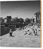 people enjoying the sunshine on the quay next to the corrib river on a sunday afternoon Galway city  Wood Print