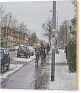 People On Bicycles In Winter Wood Print