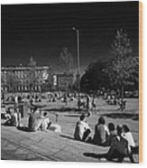 people sitting enjoying the sunshine Eyre Square in the heart of Galway city county Galway Republic of Ireland Wood Print