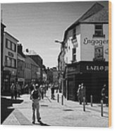 people walking down pedestrian area william street on a sunday Galway city county Galway Republic of Wood Print