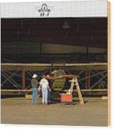 Pilot Works On Antique Plane In Hood Wood Print