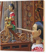 Pinocchio Inviting Tourists In Souvenirs Shop Wood Print