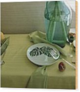 Plates, Apples And A Vase On A Green Tablecloth Wood Print