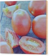 Plum Tomatoes On A Wooden Board Wood Print by Romulo Yanes