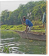 Poling A Dugout Canoe In The Rapti River In Chitwan National Park-nepal Wood Print