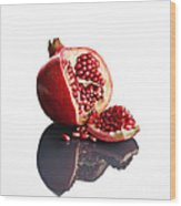 Pomegranate Opened Up On Reflective Surface Wood Print by Johan Swanepoel