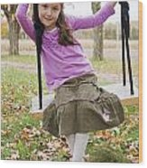 Portrait Of Young Girl On Swing Wood Print by Vast Photography