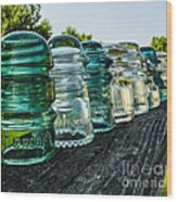 Pretty Glass Insulators All In A Row Wood Print by Deborah Smolinske