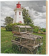 Prince Edward Island Lighthouse With Lobster Traps Wood Print by Edward Fielding