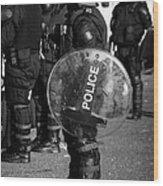 Psni Officer In Full Riot Gear With Shield On Crumlin Road At Ardoyne Shops Belfast 12th July Wood Print by Joe Fox
