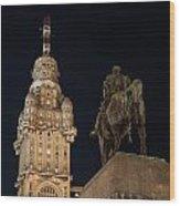 Public Statue And Skyscraper At Night Wood Print