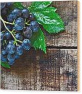 Purple Grapes On A Rustic Wooden Table Wood Print