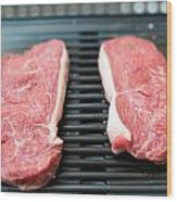 Raw Beef Steaks On The Barbecue Wood Print