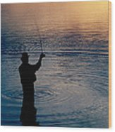 Rear View Of Fly-fisherman Silhouetted Wood Print