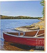 Red Canoe On Shore Wood Print