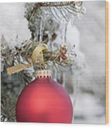 Red Christmas Ornament On Snowy Tree Wood Print