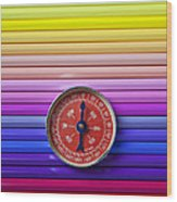 Red Compass On Rolls Of Colored Pencils Wood Print