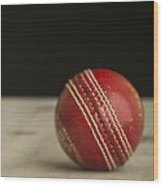 Red Cricket Ball Wood Print