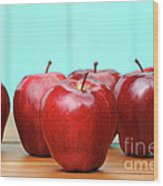 Red Delicious Apples On Old School Desk Wood Print