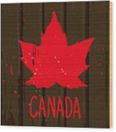 Red Maple Leaf On Brown Wood Wall Wood Print