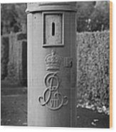 red old historic post pillar box manufactured by Handyside of Derby and London with Edward the seventh crown E Rex and VII symbols Wood Print