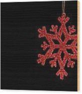 Red Snow Flake On A Black Background Wood Print