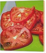 Red Tomato Slices And Knife On Green Chopping Board Wood Print
