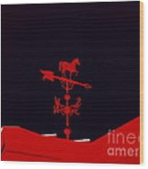 Red Weather Vane With Snow On The Roof Wood Print