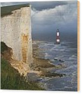White Cliffs And Red-white Striped Lightouse In The Sea Wood Print