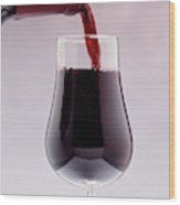 Red Wine Bottle Pouring Into A Glass Wood Print