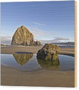 Reflection Of Haystack Rock At Cannon Beach Wood Print