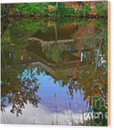 Reflection Of House On Water Wood Print