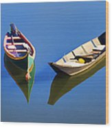 Reflections Of Two Canoes Wood Print
