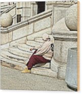 Resting On The Steps Of City Hall Wood Print