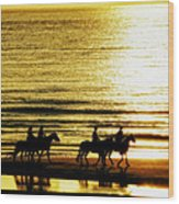 Rider Silhouettes Against The Sea Wood Print