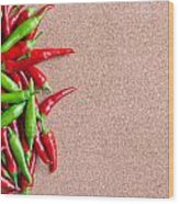 Ripe Red And Green Chillies On Cork Board Wood Print