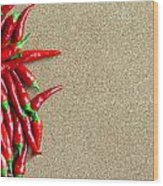 Ripe Red Chillies On Cork Board Wood Print
