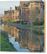 Riverside Home Reflections Vertical Wood Print by Gill Billington